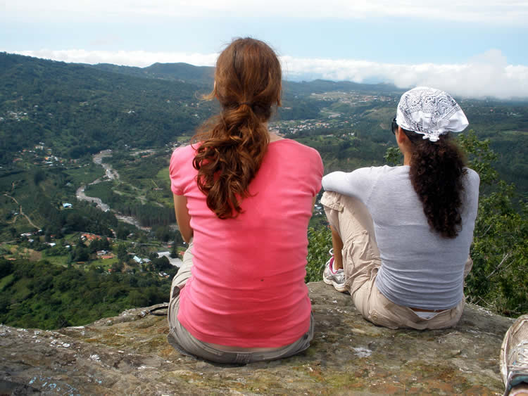 Female hikers enjoying a panaromic view of Boquete, Panama