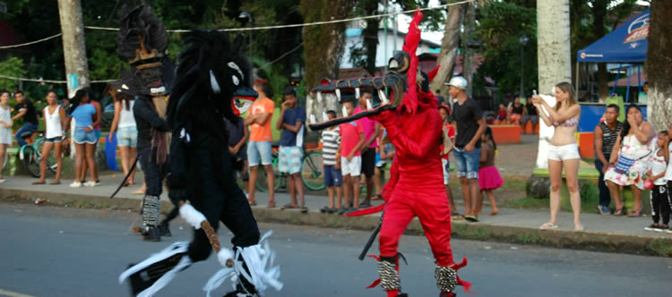 Diablos fighting on Main Street of Bocas Town during Carnivals