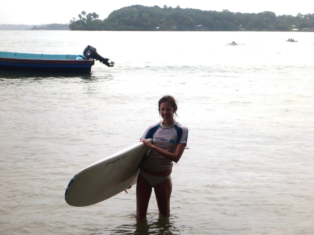 With my surf board ready to get into the water. My surf instructor calls it the magic carpet because everyone gets up on it!