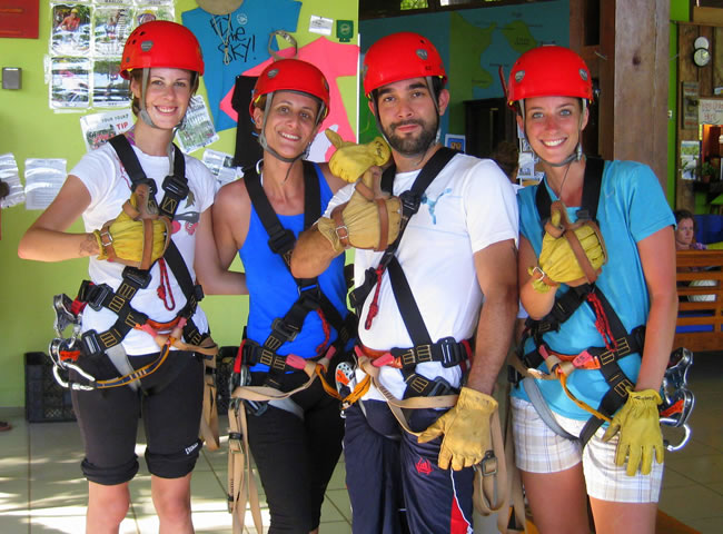 From left to right: Evelyne, Melissa, Carlos and I all geared up for the Zipline Canopy Tour in Bastimentos