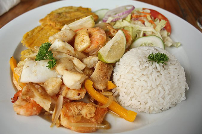 Fresh seafood with coconut flavored rice and fried plantains, simply DELICIOUS!