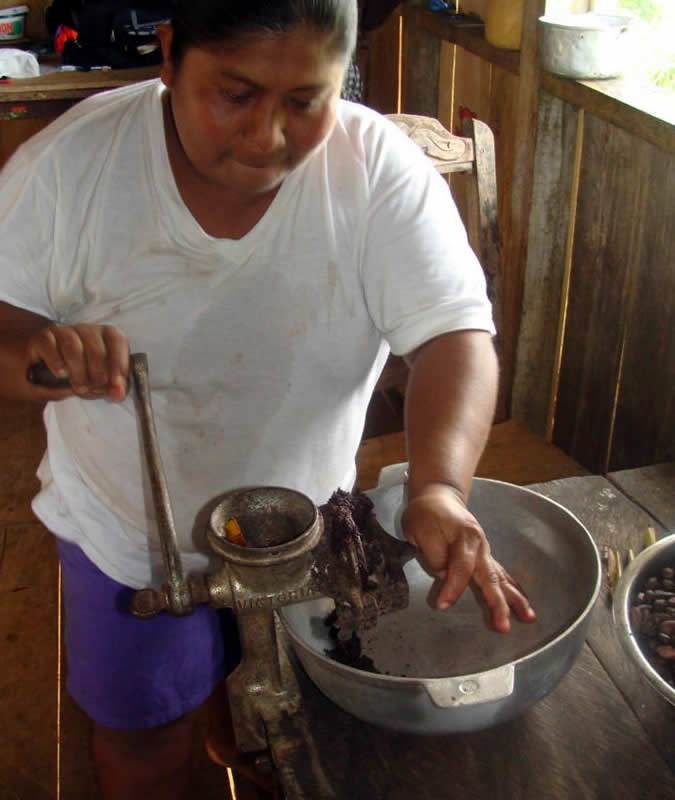 Grinding cacao for drinking and selling chocolate!