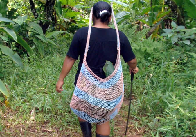 After a long day on the farm, carrying back freshly picked vegetables, fruit, and/or firewood in the traditional bag – the chácara.