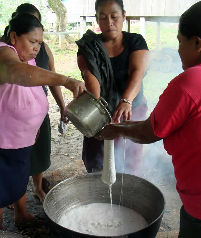 "Making coconut oil – a labor intensive but no-cost way to have cooking oil. They are cooking over a ""fogón"", which is the traditional way to cook meals over a fire."