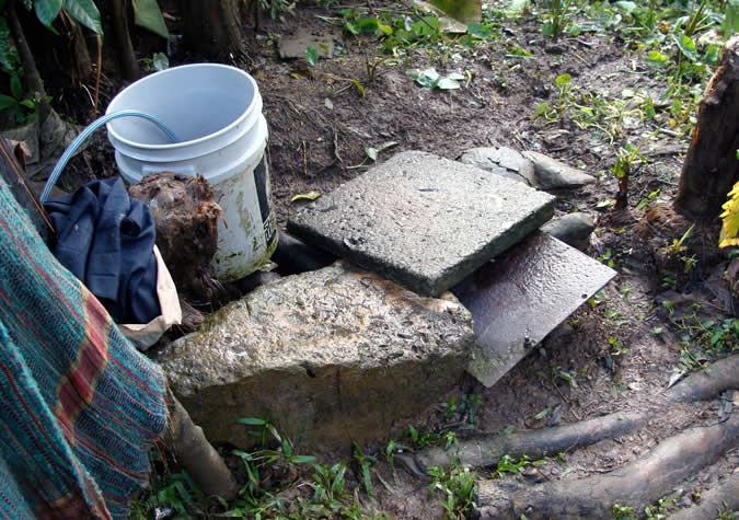 No indoor plumbing means bucket bath! The stone tablets are for washing clothes.