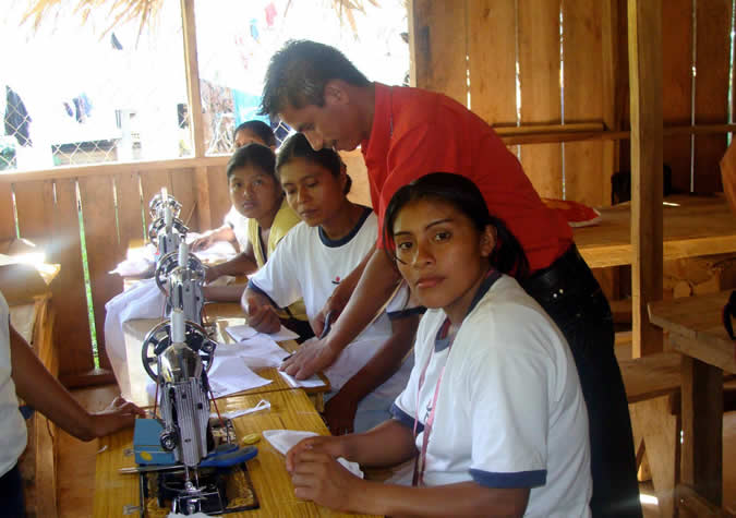 Sewing class funded by the government (including a donation of 8 sewing machines for the community) so that women could learn how to make their children's school clothes and/or go into business for themselves as a tailor.