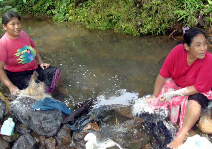 Washing clothes in the creek.
