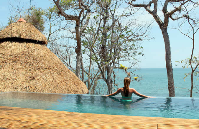 Views to infinity from the upper tier of the pool at the Isla Palenque Villa Estate hotel.