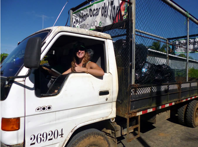 Casie Dean, local business owner, volunteering her time to drive the recycling truck